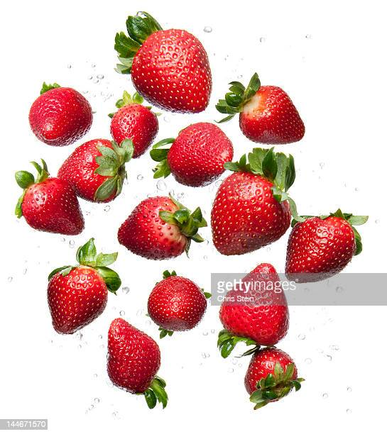 flying strawberries - strawberry stock pictures, royalty-free photos & images