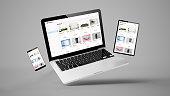 flying tablet, laptop and mobile phone showing online shop website