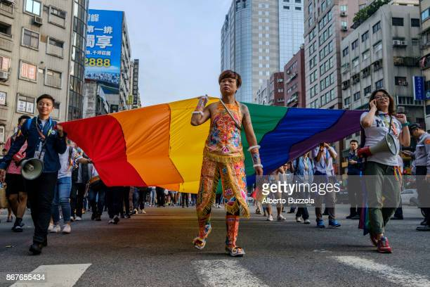 Flying the signature rainbow flag LGBT supporters pared in tenth of thousands at the 2017 LGBT Pride Parade in central Taipei Taiwan is the first...