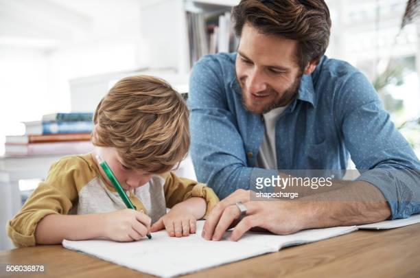 Flying through his homework with Dad's help