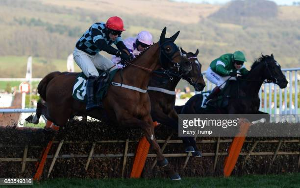 Flying Tiger ridden by Richard Johnson jump the last to win the Fred Winter Juvenile Handicap Hurdle during Ladies Day of the Cheltenham Festival at...