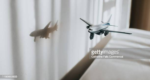 flying toy plane - country geographic area stock pictures, royalty-free photos & images