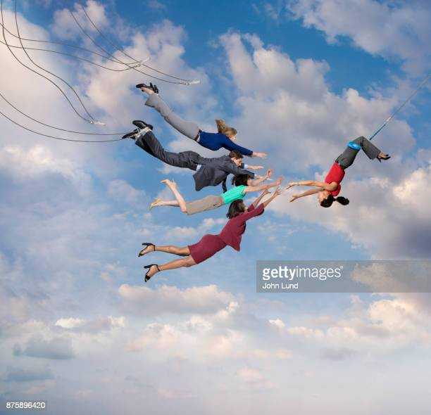 flying trapeze challenge - trapeze artist stock photos and pictures