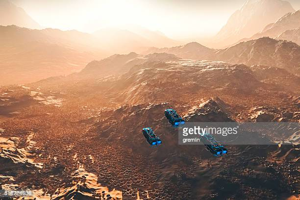flying ufos over strange alien landscape - ancient civilization stock photos and pictures