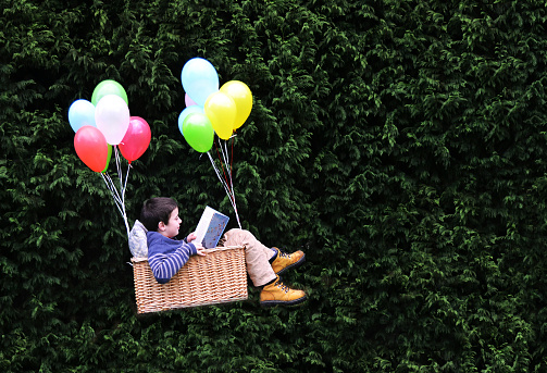 Flying with a good book - gettyimageskorea