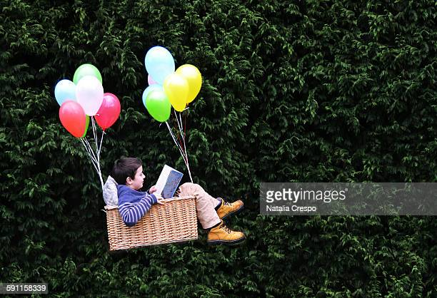 flying with a good book - storytelling stock pictures, royalty-free photos & images