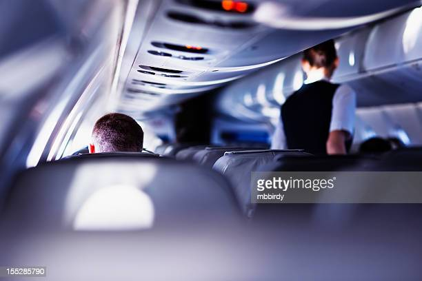 flying with airplane - vehicle interior stock pictures, royalty-free photos & images