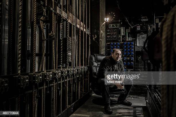 Flyman John Ryan poses for a portrait in the fly gallery at the Hackney Empire on December 17 2014 in London England Hackney Empire is currently...