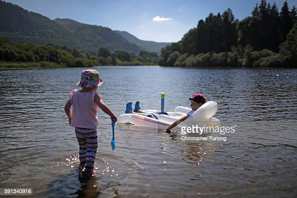 Flyn Bryant aged 11 and his sister Roux cool off in the shallows of Derwent Water on August 17 2016 in Keswick England The Lake District continues to...