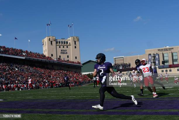 Flynn Nagel of the Northwestern Wildcats scores a touchdown against the Nebraska Cornhuskers during the second half on October 13 2018 at Ryan Field...