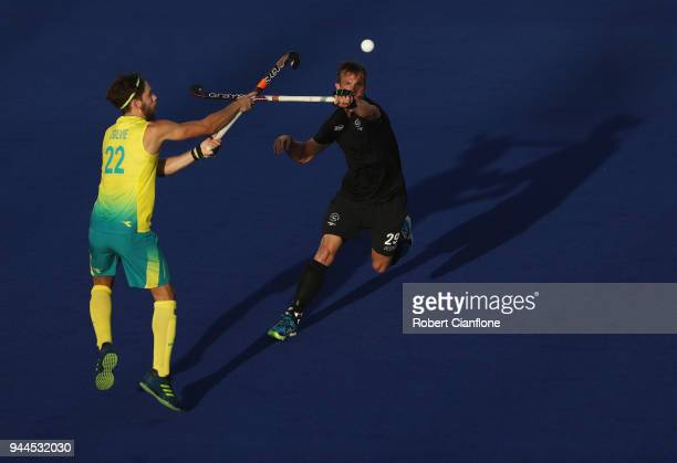Flynn Ogilvie of Australia and Hugo Inglis of New Zealand compete for the ball during the Men's Hockey match between Australia and New Zealand on day...