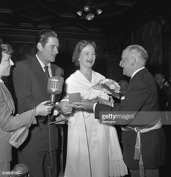 Flynning a Bride Monte Carlo Film actor Errol Flynn and his 22yearold actress bride Patrice Wymore get a wedding souvenir from Mayor Charles Palmaro...