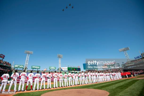 A flyover is held as members of the Boston Red Sox stand during the national anthem before the Opening Day game against the Tampa Bay Rays on April 5...