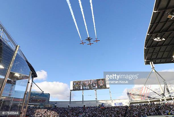 Flyover occurs during the singing of 'O Canada' performed by Brett Kissel accompanied by Doc Walker prior to NHL action between the Winnipeg Jets and...