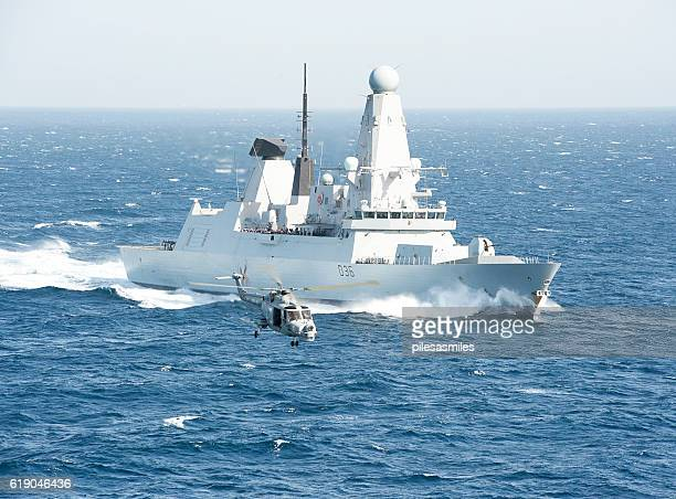 flypast in the arabian sea - military ship stock pictures, royalty-free photos & images