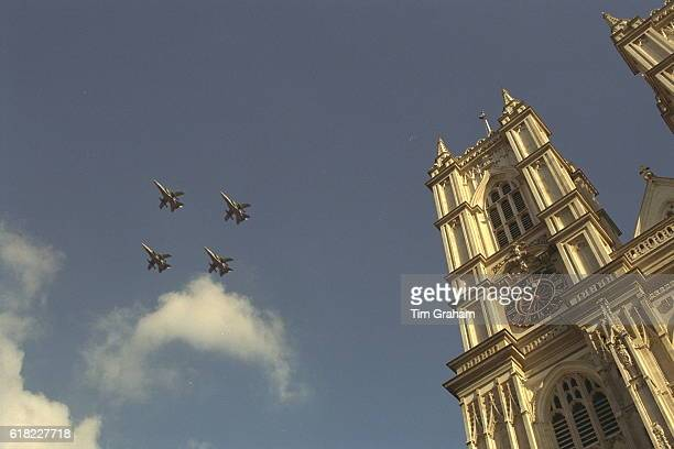 Flypast of RAF airplanes in blue sky over Westminster Abbey in London Aeroplanes Upward view