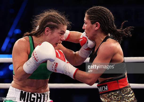 US Flyweight boxer Melissa McMorrow and German challenger Nadia Raoui exchange punches during the WBO and WIBF World Championship Female Flyweight...