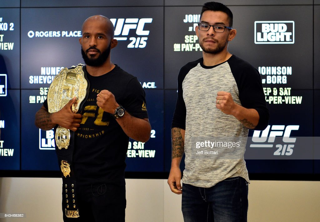 UFC flyweight champion Demetrious Johnson and Ray Borg pose for the media during the UFC 215 Ultimate Media Day at Rogers Place on September 6, 2017 in Edmonton, Alberta, Canada.