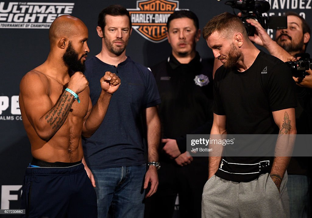 UFC flyweight champion Demetrious Johnson and Tim Elliott face off during the TUF Finale weigh-in in the Palms Resort & Casino on December 2, 2016 in Las Vegas, Nevada.