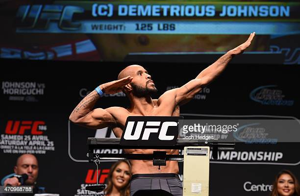 UFC flyweight champion Demetrious Johnson of the United States weighs in during the UFC 186 weighin at Metropolis on April 24 2015 in Montreal Quebec...