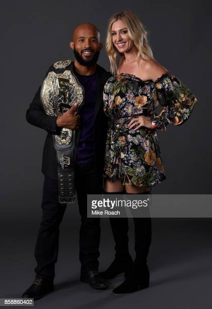 UFC flyweight champion Demetrious Johnson poses for a portrait backstage with his wife Destiny after his victory over Ray Borg during the UFC 216...