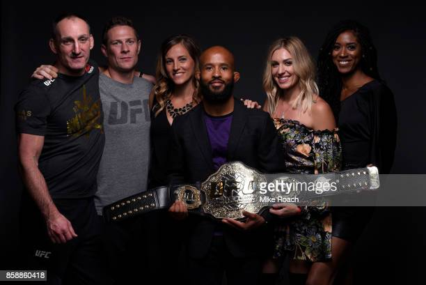 UFC flyweight champion Demetrious Johnson poses for a portrait backstage with his family and team after his victory over Ray Borg during the UFC 216...