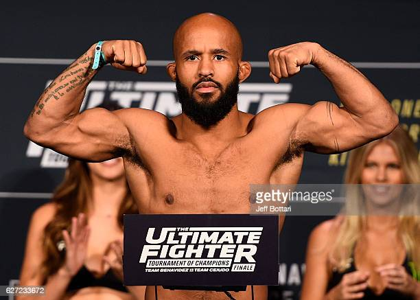 UFC flyweight champion Demetrious Johnson steps onto the scale during the TUF Finale weighin in the Palms Resort Casino on December 2 2016 in Las...