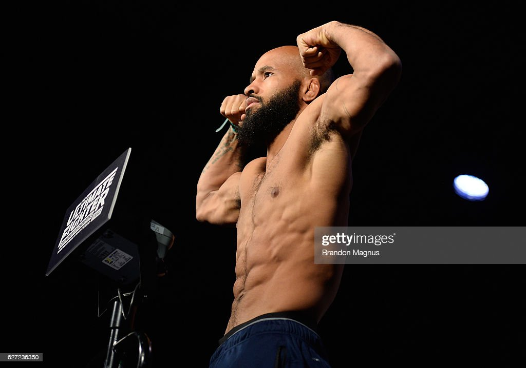 UFC flyweight champion Demetrious Johnson steps onto the scale during the TUF Finale weigh-in in the Palms Resort & Casino on December 2, 2016 in Las Vegas, Nevada.