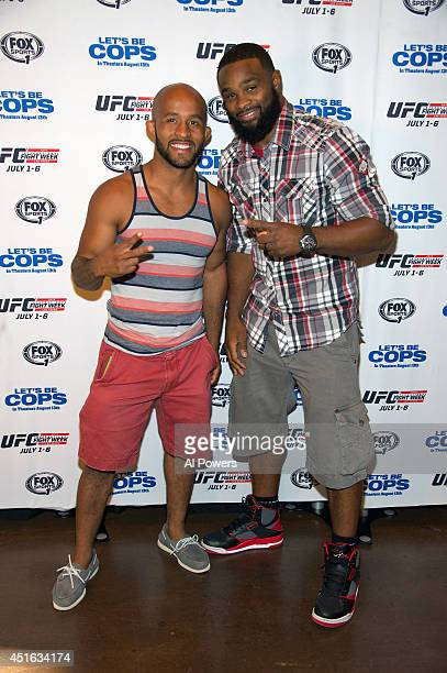 UFC flyweight champion Demetrious 'Mighty Mouse' Johnson and UFC middleweight fighter Tyron Woodley arrive at UFC's advance screening of the...