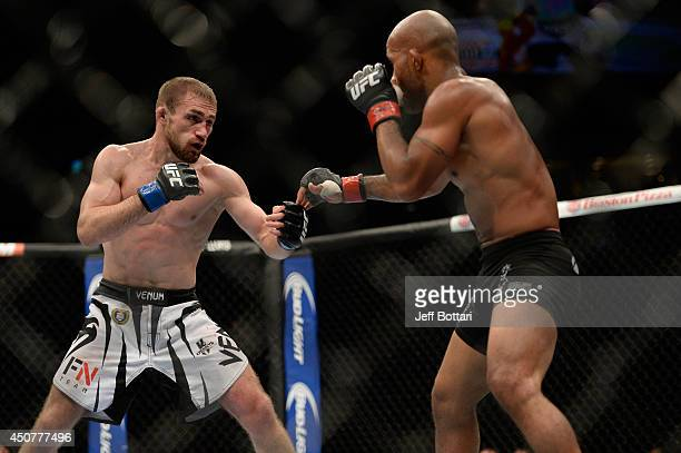 UFC Flyweight Champion Demetrious 'Mighty Mouse' Johnson looks to strike Ali Bagautinov during their flyweight championship bout at the UFC 174 event...