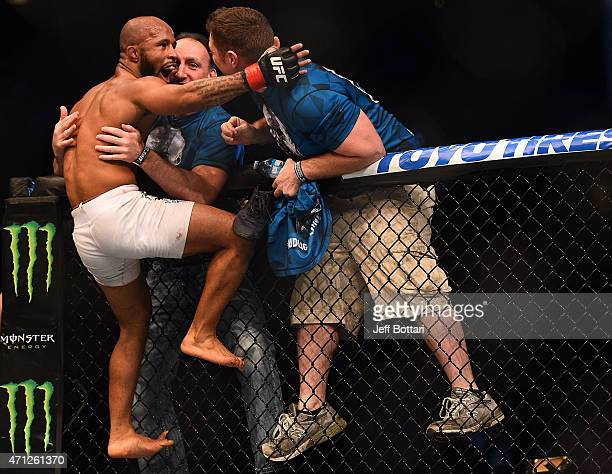 UFC flyweight champion Demetrious 'Mighty Mouse' Johnson of the United States celebrates with his corner after defeating Kyoji Horiguchi of Japan by...
