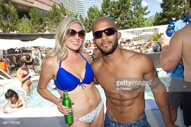 UFC flyweight champion Demetrious 'Mighty Mouse' Johnson poses with his wife Destiny at the UFC pool party during UFC International Fight Week at the...