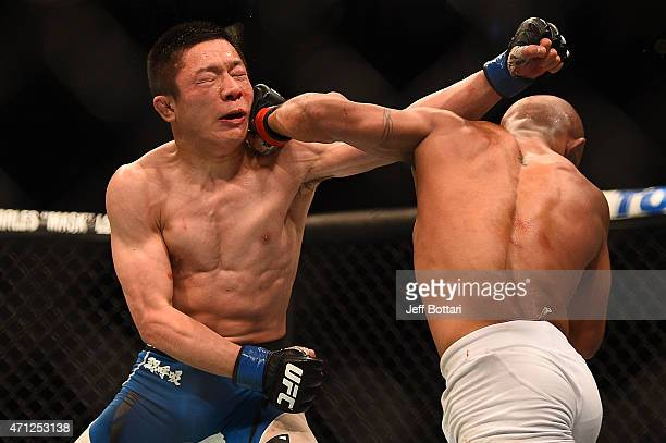UFC flyweight champion Demetrious 'Mighty Mouse' Johnson punches Kyoji Horiguchi of Japan in their UFC flyweight championship bout during the UFC 186...