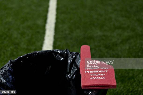 A foam finger reading Thank You President Trump sits on the edge of a garbage can ahead of a speech by US President Donald Trump not pictured during...