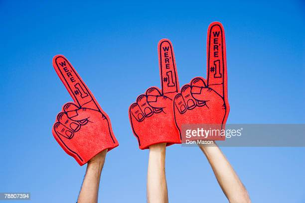 foam fingers - foam finger stock photos and pictures
