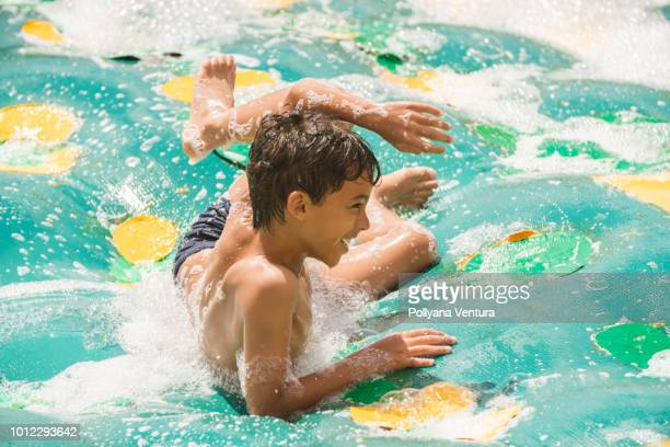 foam party in the inflatable pool - covering stock pictures, royalty-free photos & images