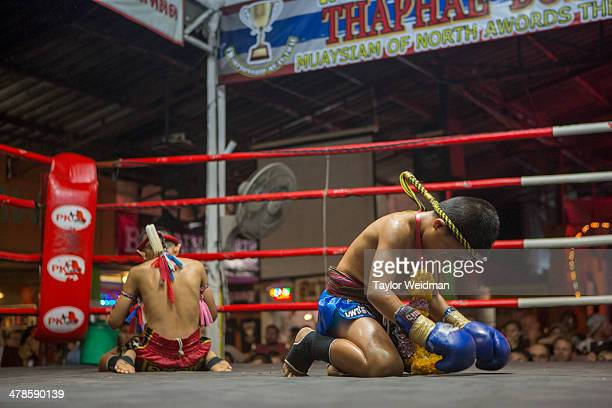 Focus and his opponent perform an elaborate ritual before their fight at the Thapae Muay Thai Stadium in Chiang Mai He lost the fight but he was...