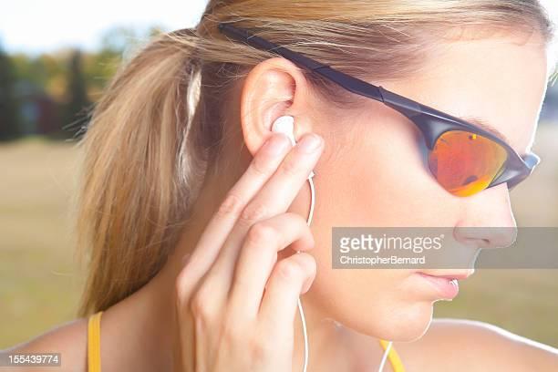 Focus female runner with sunglasses