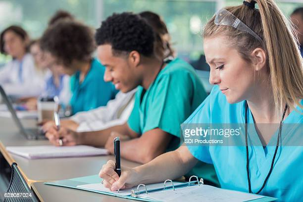 Focus medical students take notes during lecture