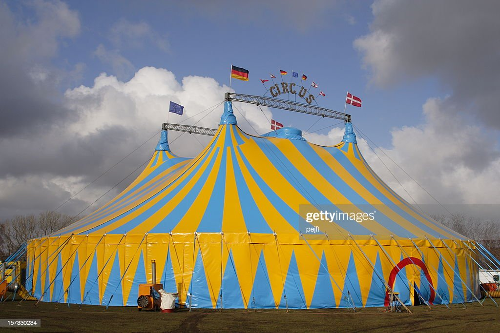 Focus on Circus tent with dramatic cloudscape background : Stock Photo