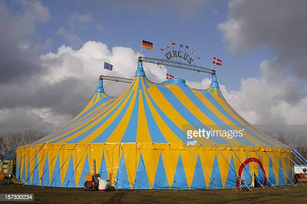 focus on circus tent with dramatic cloudscape background - pejft stock pictures, royalty-free photos & images