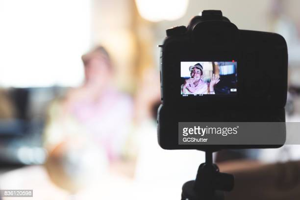 Focus on the viewfinder of the camera of a video blogger