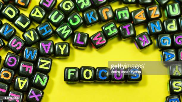 Focus Text With Colorful Alphabet Blocks On Yellow Background