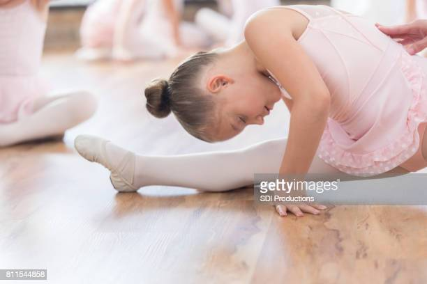 focused ballerina does the splits - little girls dressed up wearing pantyhose stock photos and pictures