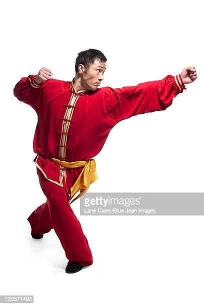 focused man doing martial arts in chinese clothing - traditional clothing stock pictures, royalty-free photos & images