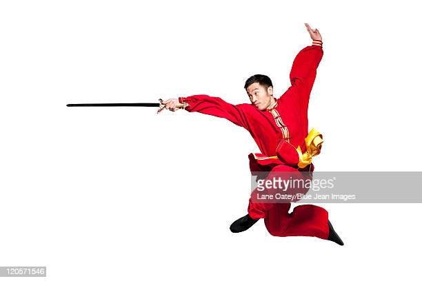 focused man doing martial arts in chinese clothing - 武道 ストックフォトと画像