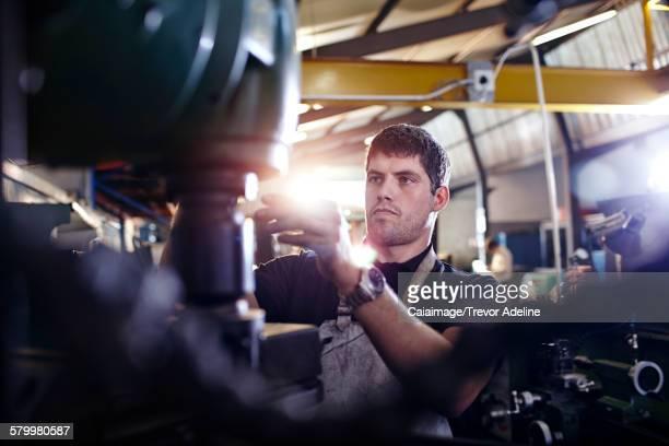 Focused mechanic working in auto repair shop