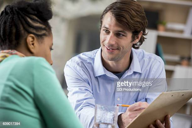 Focused mid adult Caucasian entrepreneur meets with female client