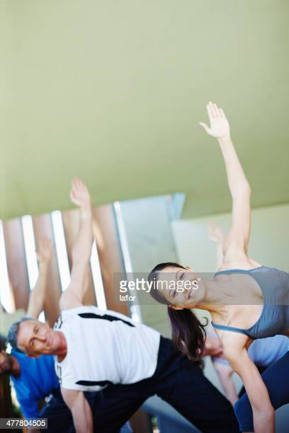 focused on acheiving greater wellbeing - teacher bending over stock photos and pictures