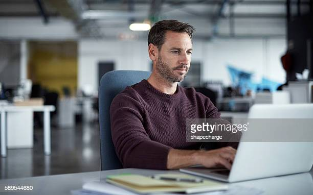 focused on meeting his deadlines - stubble stock pictures, royalty-free photos & images